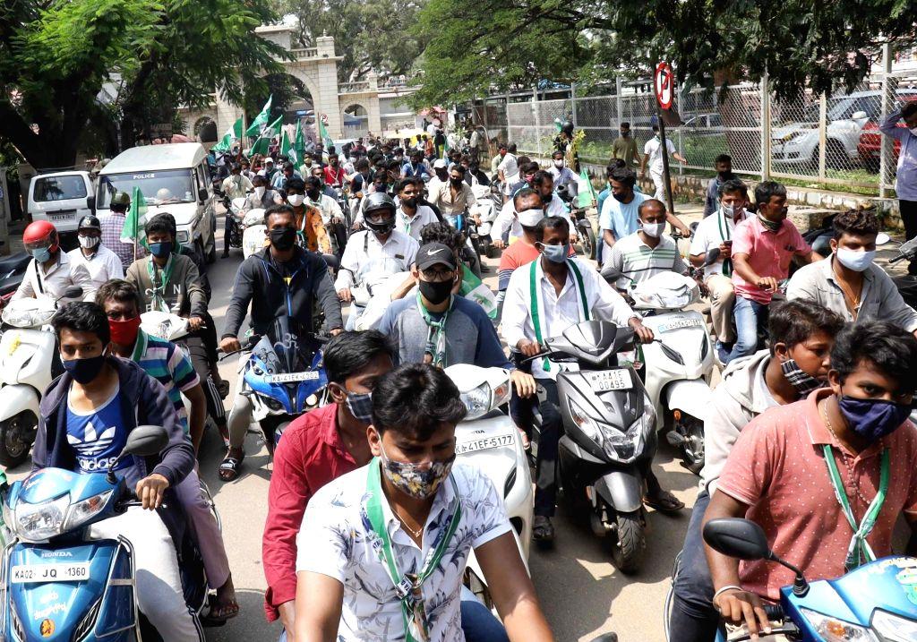 JD-S leaders Nikhil Kumarswamy AND TA Sharavana campaign for the party's Rajarajeshwari candidate Krishna Murthy ahead of Rajarajeshwari Nagar by-poll, in Bengaluru on Oct 27, 2020.