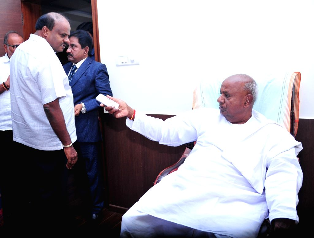 JD(S) supremo HD Devegowda and party leader HD Kumarswamy during a meeting on the upcoming By Elections in Karnataka; in Bengaluru on Nov 13, 2019.