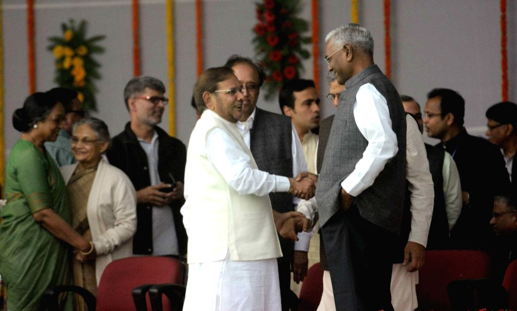 JD(U) chief Sharad Yadav and CPI national secretary D Raja during the swearing-in ceremony of the new JD-U-RJD-Congress coalition government in Patna, on Nov 20, 2015. - Sharad Yadav
