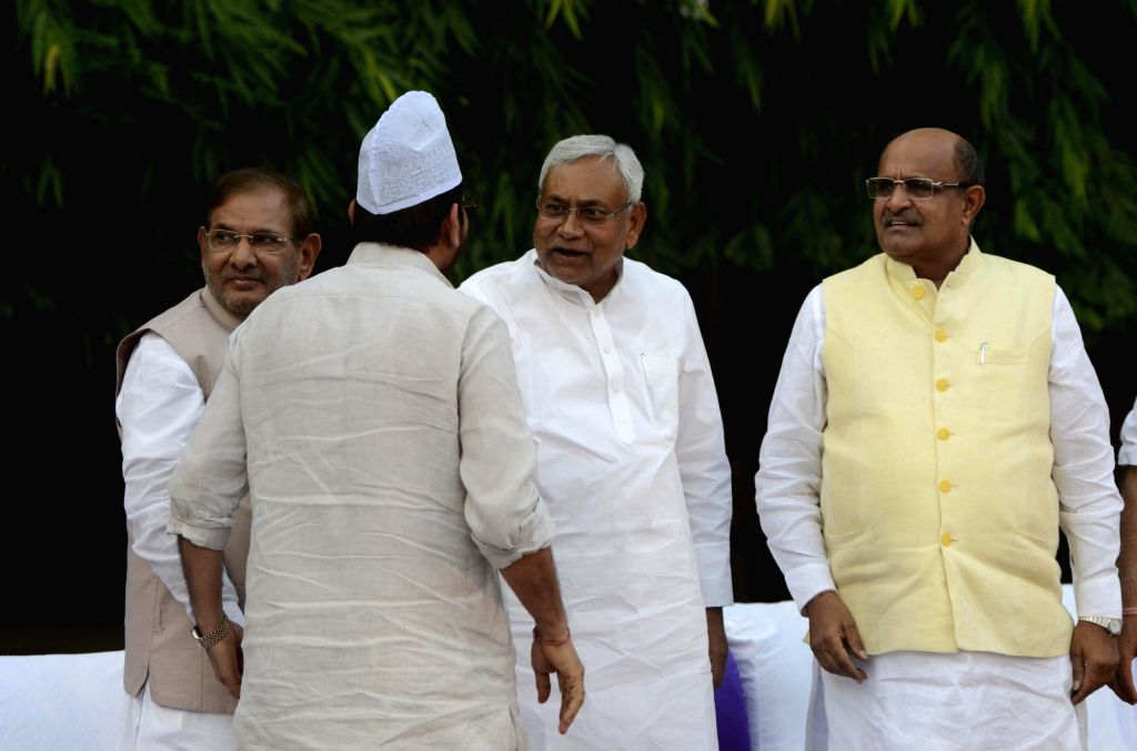 JD-U leaders Nitish Kumar, Sharad Yadav and KC Tyagi during an iftaar party hosted by the party in New Delhi on June 26, 2016. - Nitish Kumar and Sharad Yadav