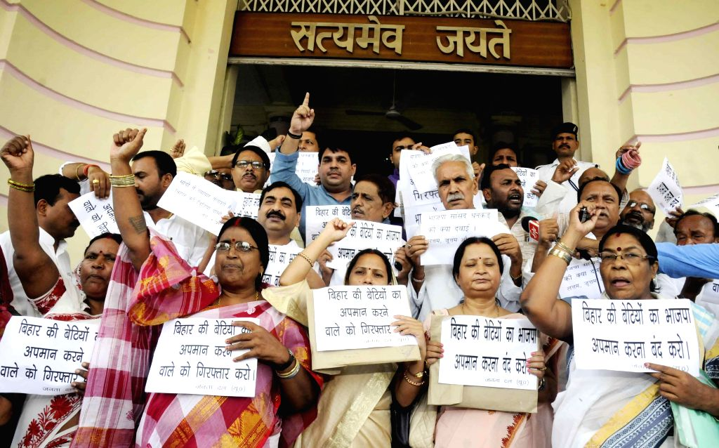 JD(U) legislators demonstrate against BJP's National Kisan Morcha president, OP Dhankar's remarks on Bihari women in Patna on July 7, 2014.