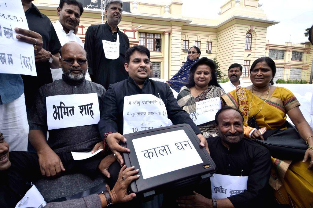 JD(U) legislators stage a demonstration at Bihar assembly in Patna, on Aug 5, 2015.