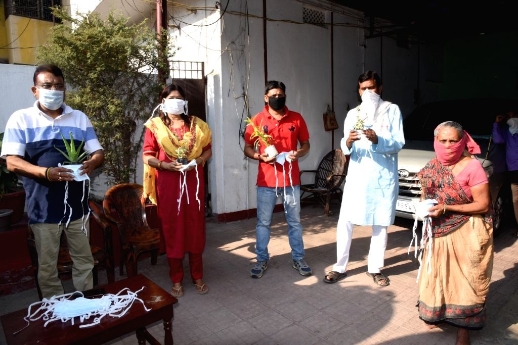 JD-U MLC Ranbir Nandan distributes masks and hand sanitisers among people on the occasion of World Earth Day in Patna during the extended nationwide lockdown imposed to mitigate the spread of ...