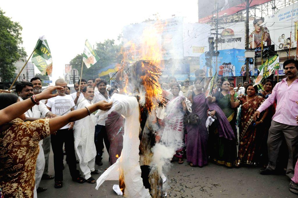 JD(U) workers demonstrate against BJP's National Kisan Morcha president, OP Dhankar's remarks on Bihari women in Patna on July 7, 2014.