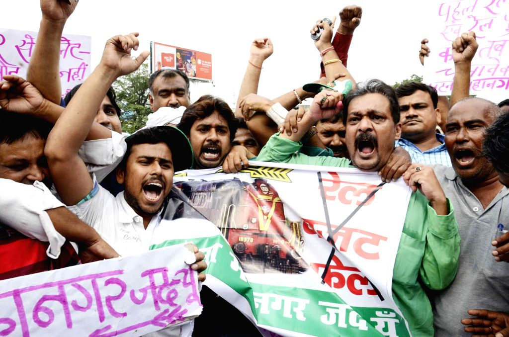 JD (U) workers demonstrate against Rail budget 2014-15 which was presented in the Parliament by Union Railway Minister D.V. Sadananda Gowda in Patna on July 8, 2014. - D.