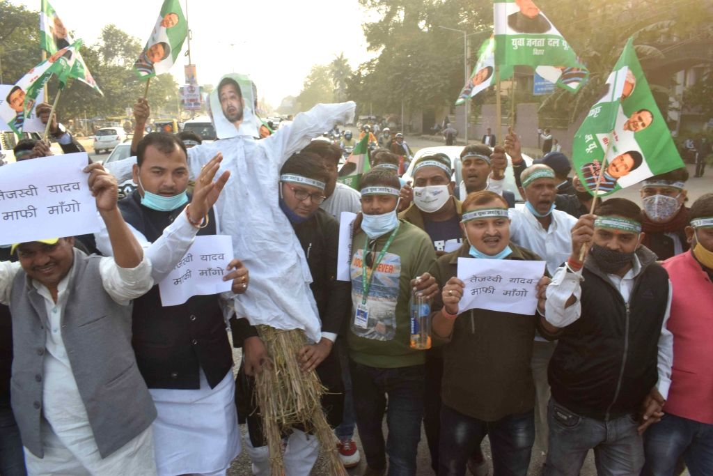 JD-U workers protest against RJD leader Tejashwi Yadav for his comments that Chief Minister Nitish Kumar did not sire another child as he was afraid of becoming father to a female child; in ... - Nitish Kumar and Tejashwi Yadav