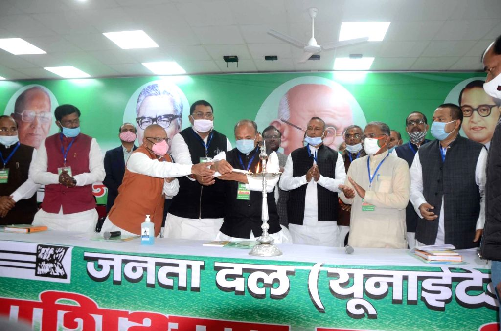 JDU national president Ram Chandra Prasad (RCP) Singh   lighting a lamp during the workers training workshop at party office in Patna on Saturday February 20,2021  .