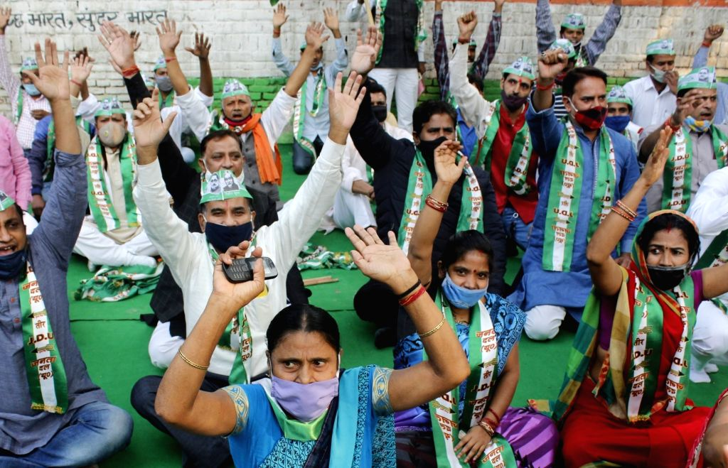 JDU supporter during a protest against Delhi Govt after it said that no Chhath puja will happen at public places in Delhi due to COVID-19, at Jantar Mantar in New Delhi on November 15, ...