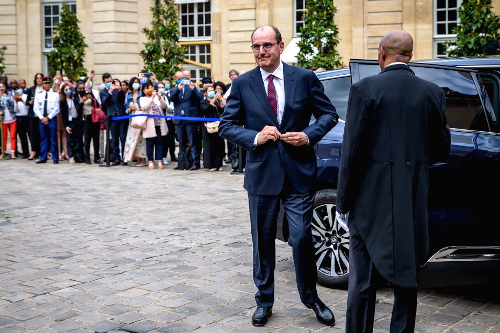 Jean Castex (L, Front) arrives to attend the handover ceremony in the courtyard of the Hotel Matignon in Paris, France, on July 3, 2020. Jean Castex, a 55-year-old top ...