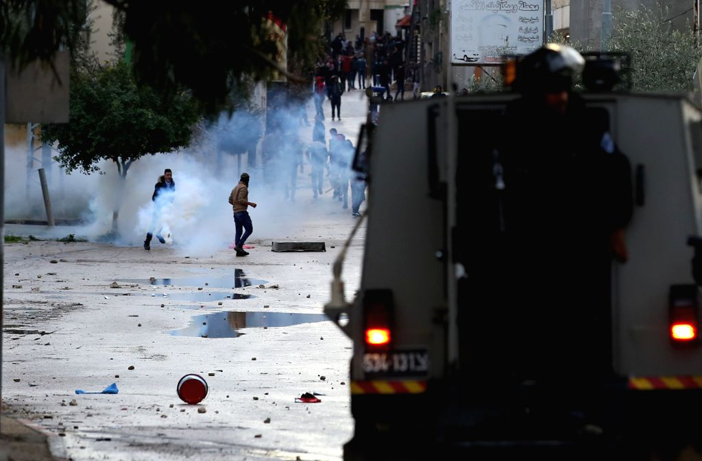 JENIN, Jan. 18, 2018 - Clashes break out between Palestinians and Israeli soldiers in the West Bank city of Jenin, on Jan. 18, 2018. Palestinian sources said Thursday a Palestinian man was killed ...