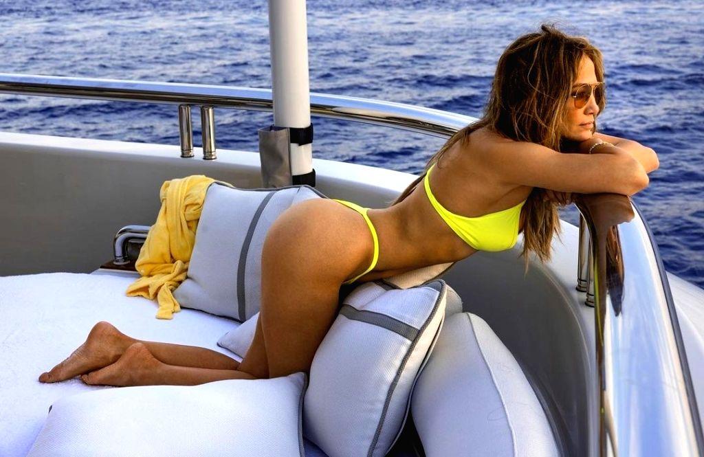 Jennifer Lopez 'gets loud' in neon bikini