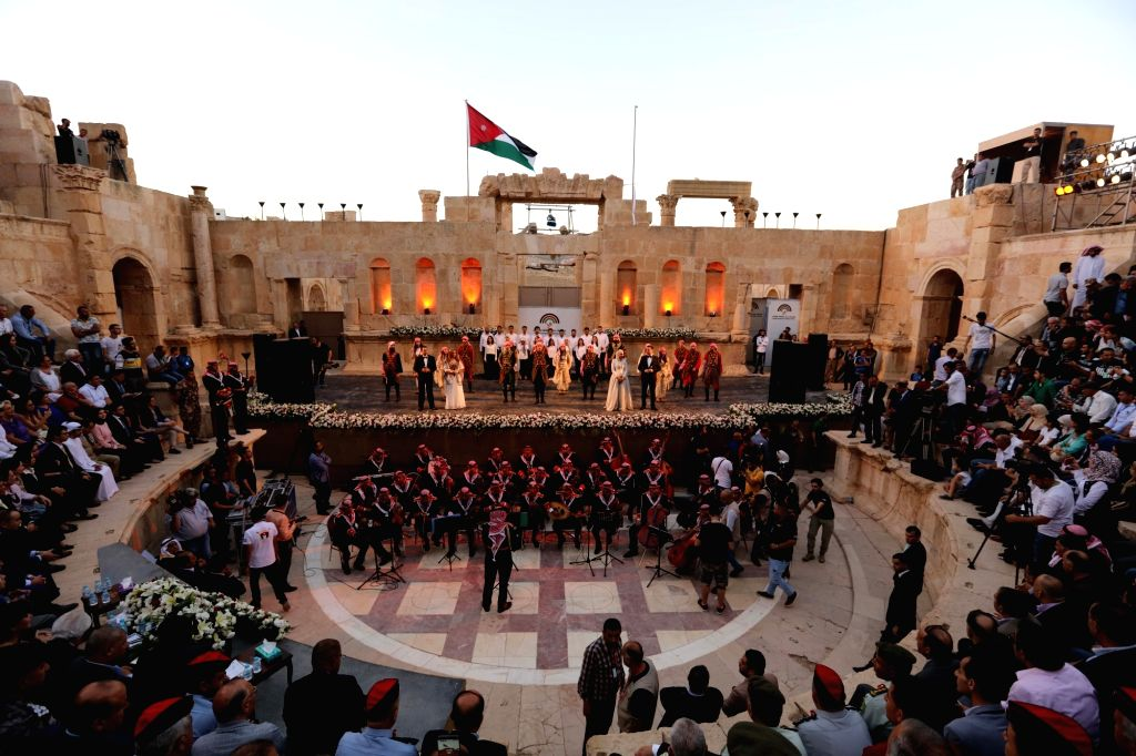 JERASH (JORDAN), July 19, 2018 People watch the performance on the opening ceremony of Jerash Festival in Jerash, Jordan, July 19, 2018. The 33rd Jerash Festival for Culture and Arts was ...
