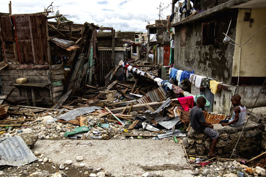 JEREMIE, Oct. 7, 2016 - Image provided by the United Nations Stabilization Mission in Haiti shows two boys playing on the debris left by Hurricane Matthew in Jeremie city, Haiti on Oct. 6, 2016. ...