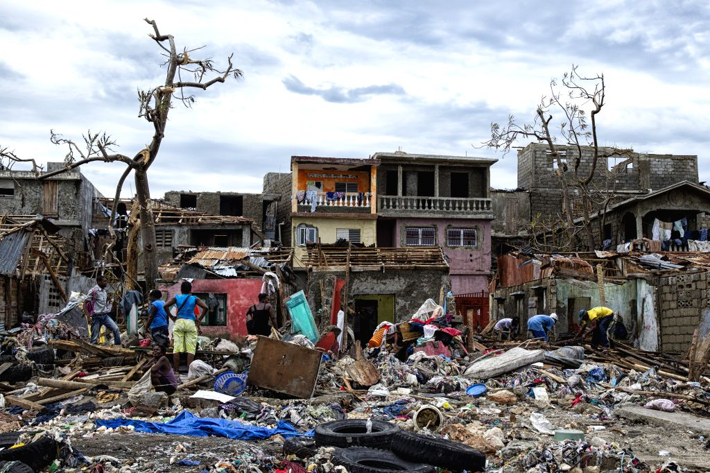 JEREMIE, Oct. 7, 2016 - Image provided by the United Nations Stabilization Mission in Haiti shows villagers saving their belongings after the pass of Hurricane Matthew in Jeremie city, Haiti, Oct. 6, ...