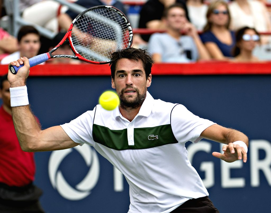 Jeremy Chardy of France returns the ball against Serbia's Novak Djokovic during their semifinal match of men's singles at the 2015 Rogers Cup in Toronto, Canada, ...