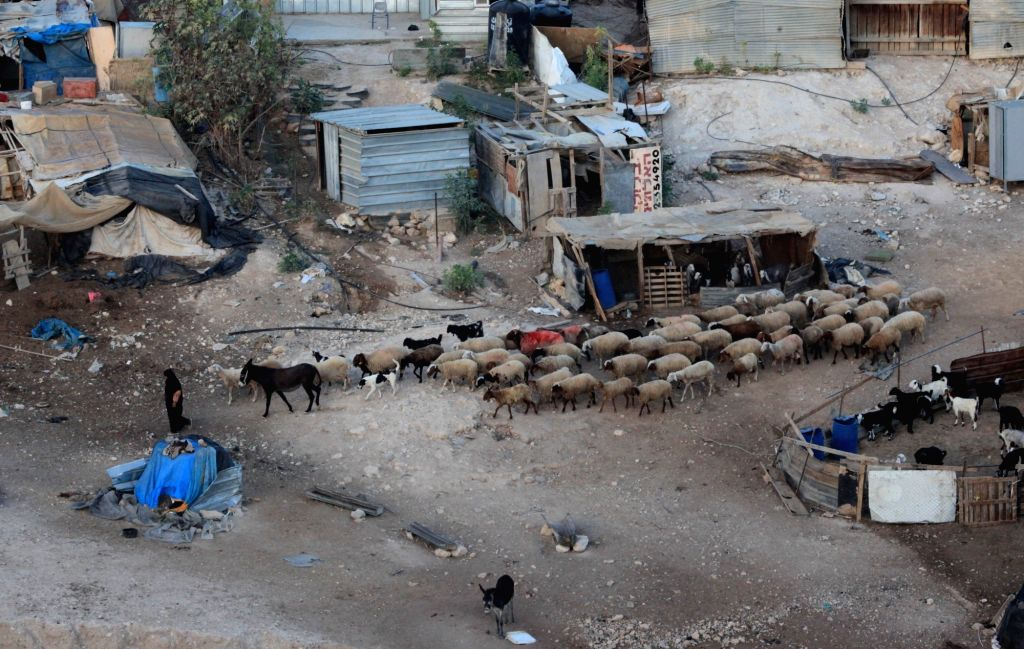 JERICHO, Sept. 17, 2018 - A Palestinian Bedouin woman herds sheep at the Bedouin community of Khan al-Ahmar, located between the West Bank city of Jericho and Jerusalem, on Sept. 17, 2018. Khan ...