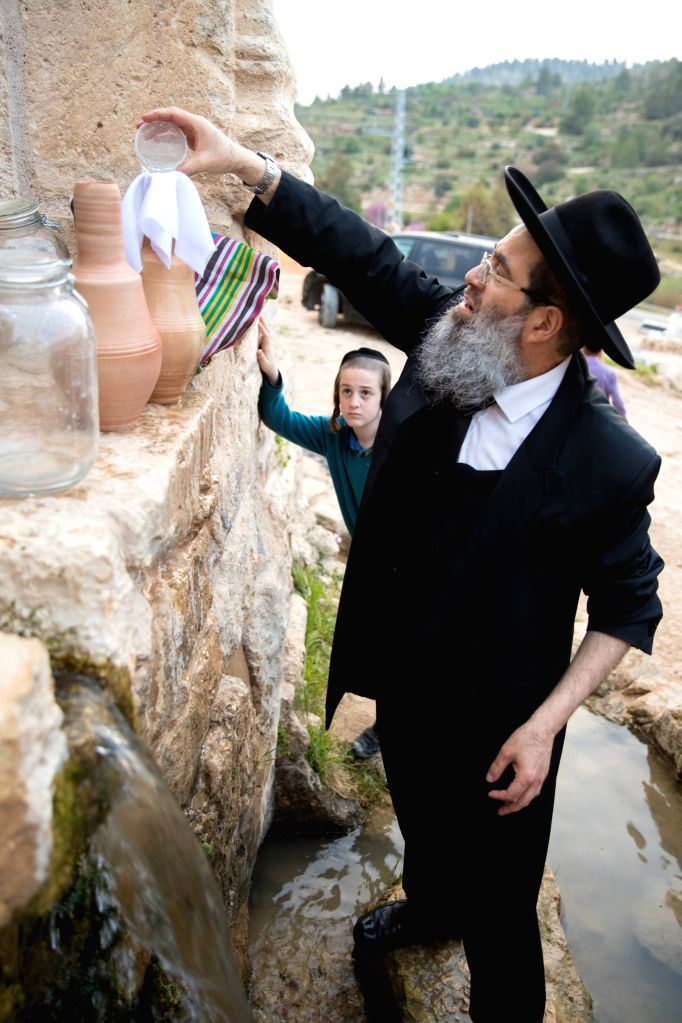 JERUSALEM, April 10, 2017 - Ultra-Orthodox Jews collect spring water for the upcoming Jewish holiday of Passover in the Jerusalem hills on April 9, 2017. Passover is an important Biblically-derived ...