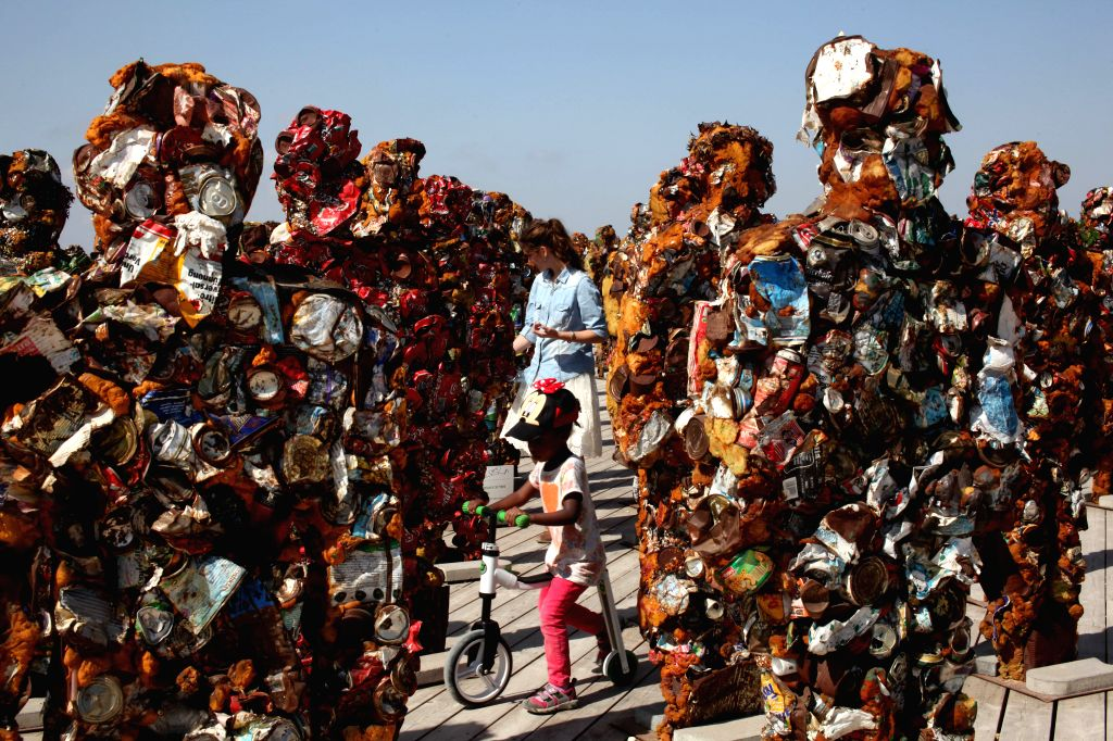 """Visitors look at """"Trash People"""" exhibition by German artist HA Schult at the Ariel Sharon Park near Tel Aviv, Israel, on April 17, 2014. Schult's ..."""