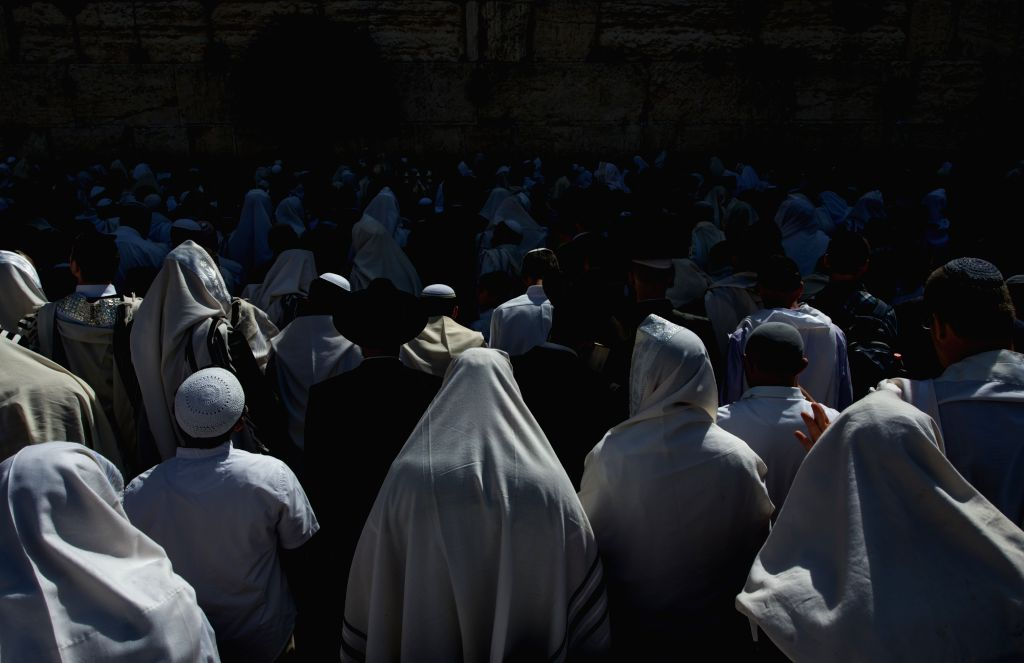 Jews pray at the Western Wall in the Old City of Jerusalem, on April 17, 2014. Passover is an important Biblically-derived Jewish festival celebrated from April .