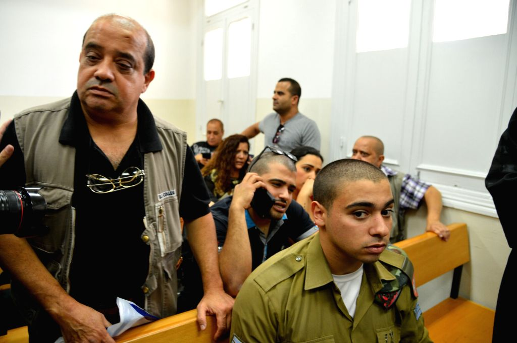 JERUSALEM, April 19, 2016 - Israeli soldier Elor Azaria (R), who was caught on video shooting a wounded Palestinian assailant, attends a hearing in Tel Aviv, Israel, on April 18, 2016. The Israeli ...