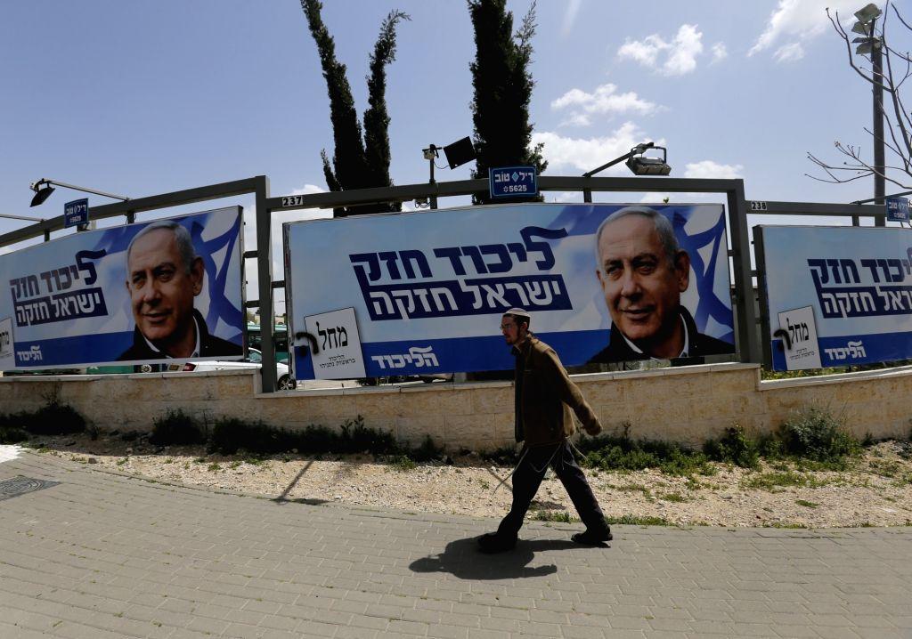 JERUSALEM, April 8, 2019 (Xinhua) -- A man walks past a Likud Party election campaign poster depicting Israeli Prime Minister Benjamin Netanyahu in Jerusalem, on April 7, 2019. (Xinhua/Muammar Awad/IANS) - Benjamin Netanyahu