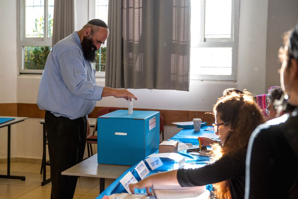 JERUSALEM, April 9, 2019 - A man votes at a polling station in Jerusalem, April 9, 2019. Israel on Tuesday morning started day-long general elections to choose its next parliament and decide the ...