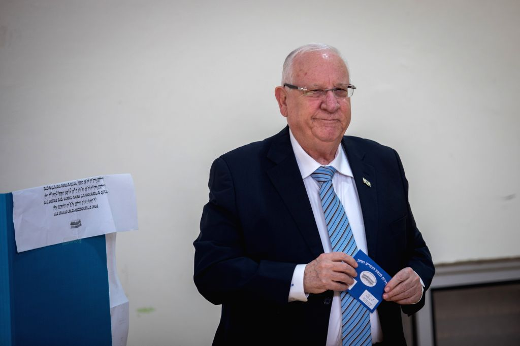 JERUSALEM, April 9, 2019 - Israeli President Reuven Rivlin casts his ballot at a polling station in Jerusalem, on April 9, 2019. Israel on Tuesday morning started day-long general elections to choose ...