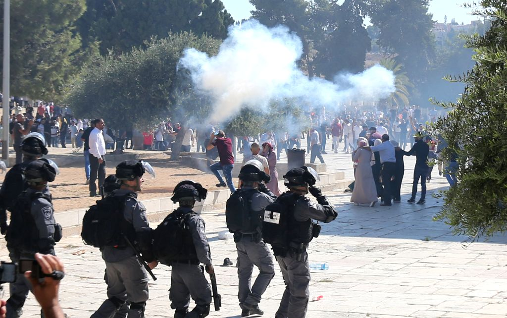 JERUSALEM, Aug. 11, 2019 - Palestinians clash with Israeli police at the Al-Aqsa Mosque compound in East Jerusalem, Aug. 11, 2019. Clashes erupted on Sunday in East Jerusalem's holy site between ...
