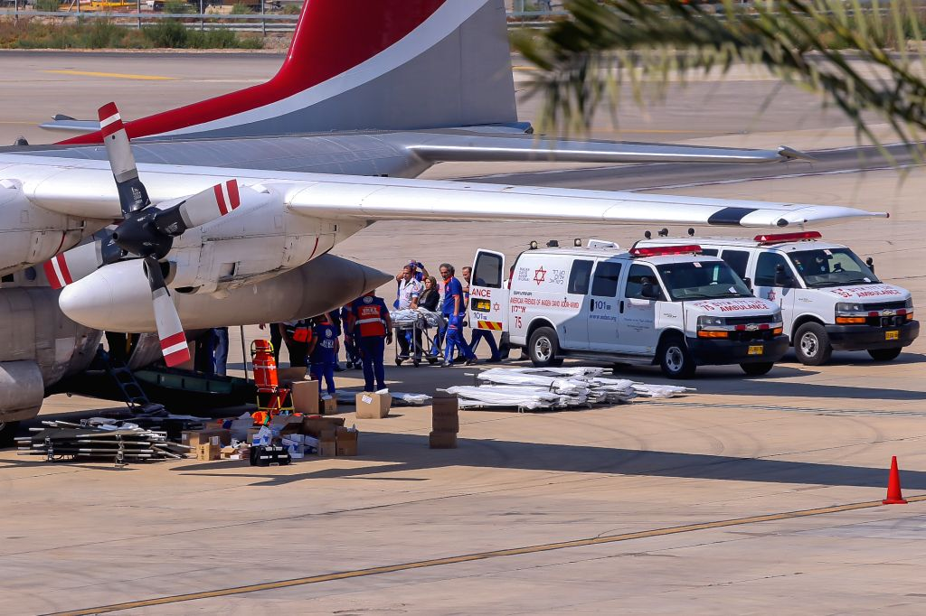 A wounded Palestinian from Gaza is carried on a stretcher onto a Turkish Airplane at Ben Gurion Airport, Israel, flying to Turkish capital Ankara for treatment, ..