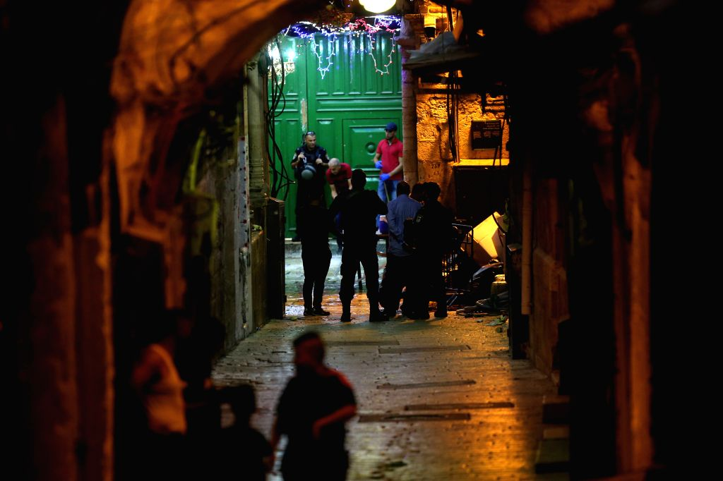 JERUSALEM, Aug. 15, 2019 - Israeli security and rescue personnel work near the scene where Palestinians were shot by Israeli police in Jerusalem's old city, on Aug. 15, 2019. One Palestinian man was ...