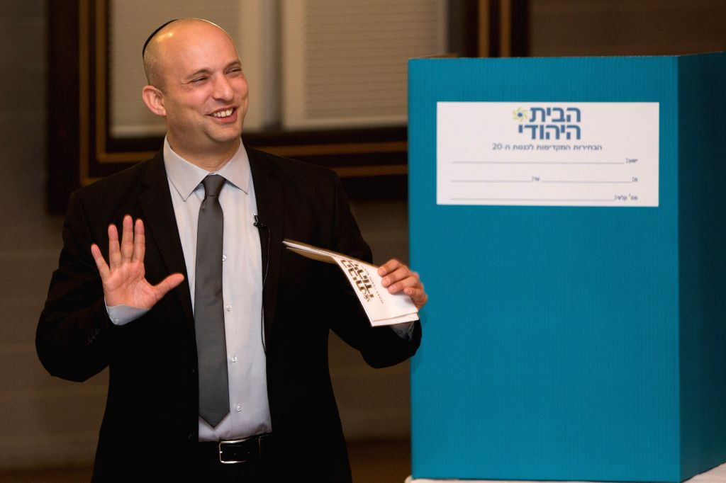 Israeli Economy Minister and the leader of the Jewish Home party Naftali Bennett attends the party's preliminary elections in Jerusalem, on Jan. 14, 2015. ...