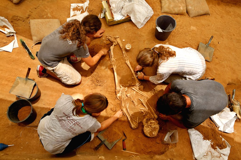 JERUSALEM, July 10, 2016 - Archaeologists and volunteers work at the archaeological site in the Ashkelon National Park, Israel, on June 28, 2016. Archeologists said on July 10, 2016 they discovered ...