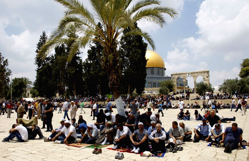 JERUSALEM, JUNE 1, 2018 - Muslim worshippers pray near the Dome of the Rock on the Al-Aqsa Mosque compound during the holy month of Ramadan in Jerusalem on June 1, 2018.