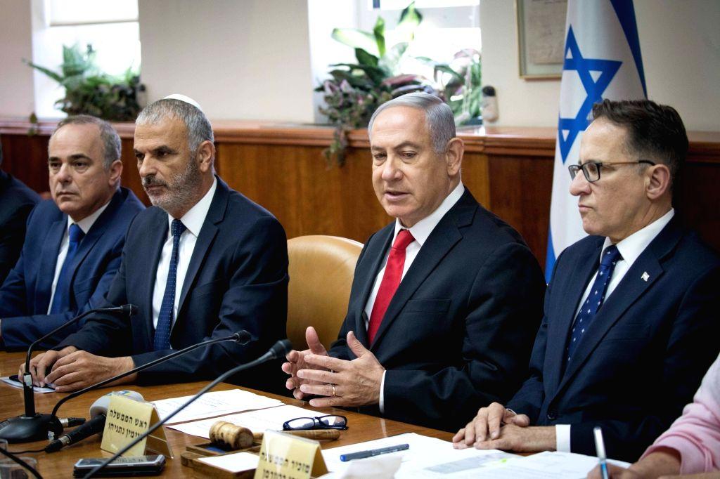 JERUSALEM, June 10, 2018 - Israeli Prime Minister Benjamin Netanyahu (2nd R) chairs the weekly cabinet meeting in Jerusalem, on June 10, 2018. Benjamin Netanyahu said Sunday that European leaders ... - Benjamin Netanyahu