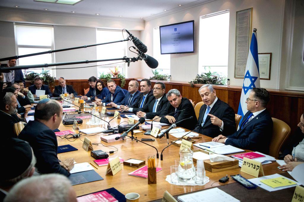 JERUSALEM, June 2, 2019 - Israeli Prime Minister Benjamin Netanyahu (2nd R) attends the weekly cabinet meeting in Jerusalem, June 2, 2019. The Israeli parliament, known as the Knesset, dissolved ... - Benjamin Netanyahu
