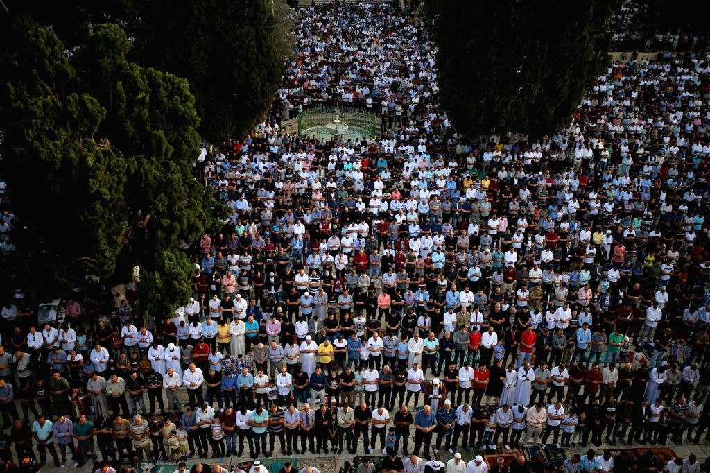 JERUSALEM, June 5, 2019 - Muslims take part in Eid al-Fitr prayers on the compound known to Muslims as Noble Sanctuary and to Jews as Temple Mount in Jerusalem's Old City, June 5, 2019. Eid al-Fitr ...