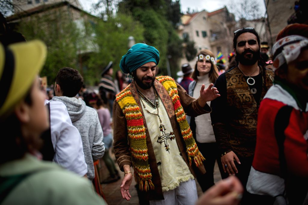 JERUSALEM, March 13, 2017 - People celebrate Purim in central Jerusalem, on March 13, 2017. Purim is a Jewish holiday that commemorates the deliverance of the Jewish people from Haman's plot during ...