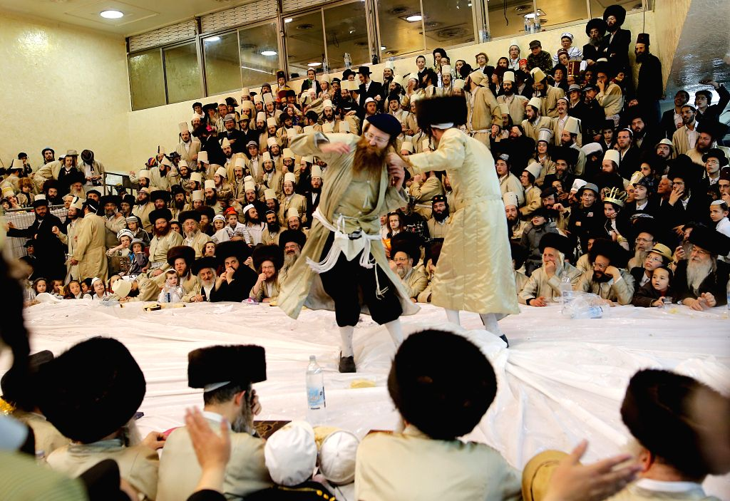 JERUSALEM, March 14, 2017 - Ultra-Orthodox Jewish men celebrate Purim at a synagogue in Mea Shearim, Jerusalem, on March 13, 2017. Purim is a Jewish holiday that commemorates the deliverance of the ...