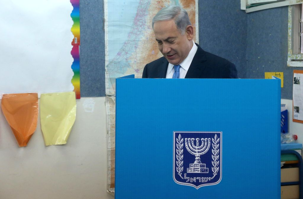 Israeli Prime Minister Benjamin Netanyahu fills in his ballot at a polling station during the parliamentary election in Jerusalem, on March 17, 2015. Israel held ... - Benjamin Netanyahu
