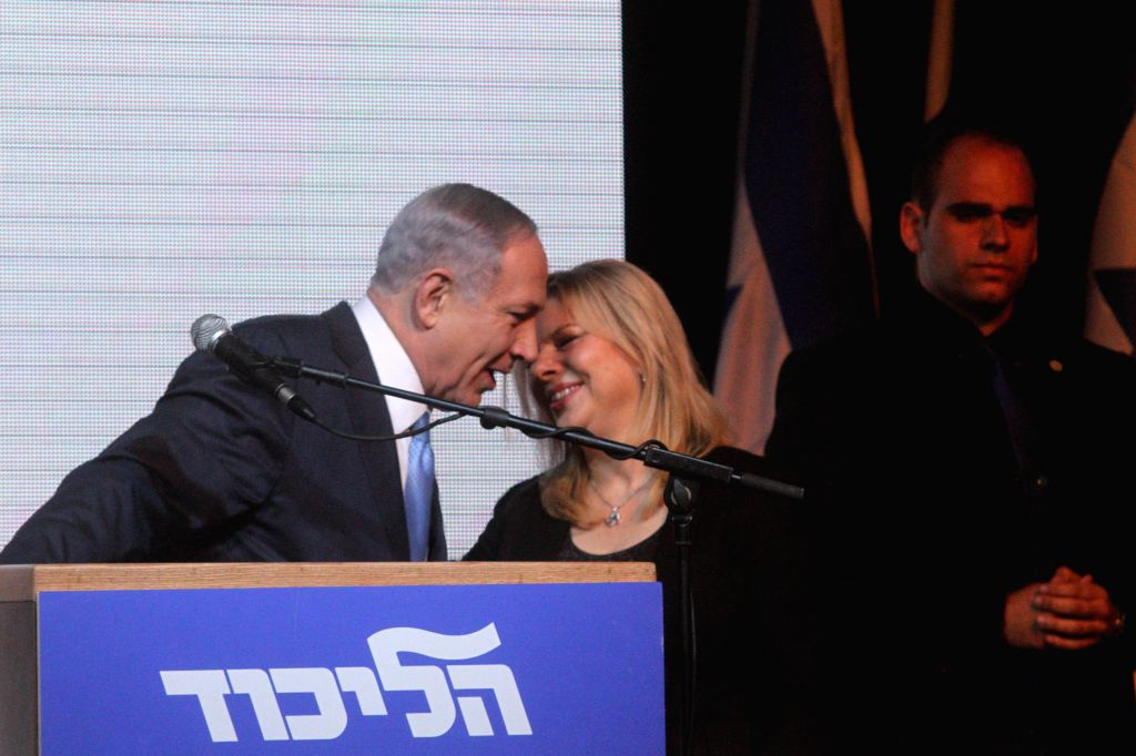 Israeli Prime Minister and Likud Party leader Benjamin Netanyahu (1st L) and his wife Sara react to exit poll results at Likud Party campaign headquarters in Tel ... - Benjamin Netanyahu
