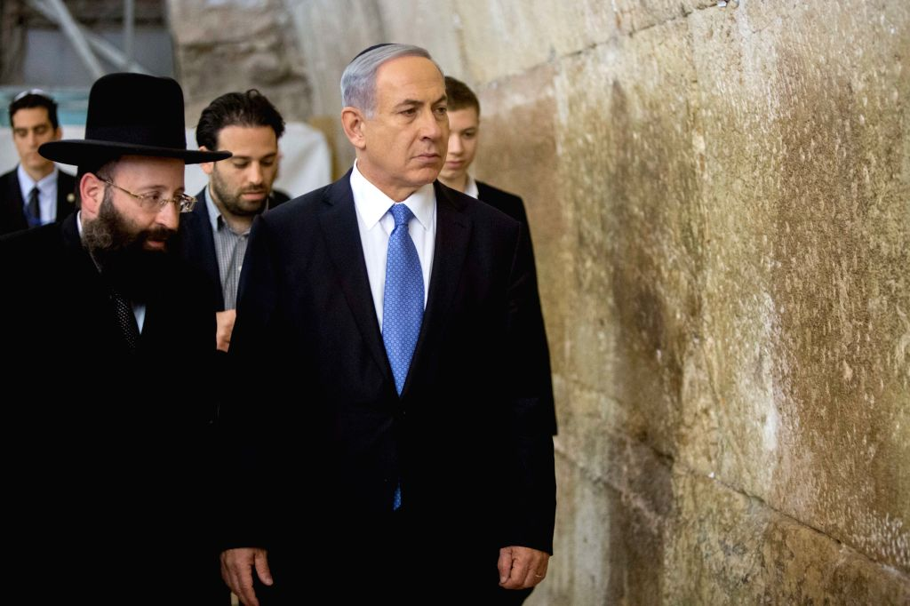 Israeli Prime Minister Benjamin Netanyahu (front) comes to pray at the Jewish site of the Western Wall in the Old City of Jerusalem, on March 18, 2015. Incumbent ... - Benjamin Netanyahu