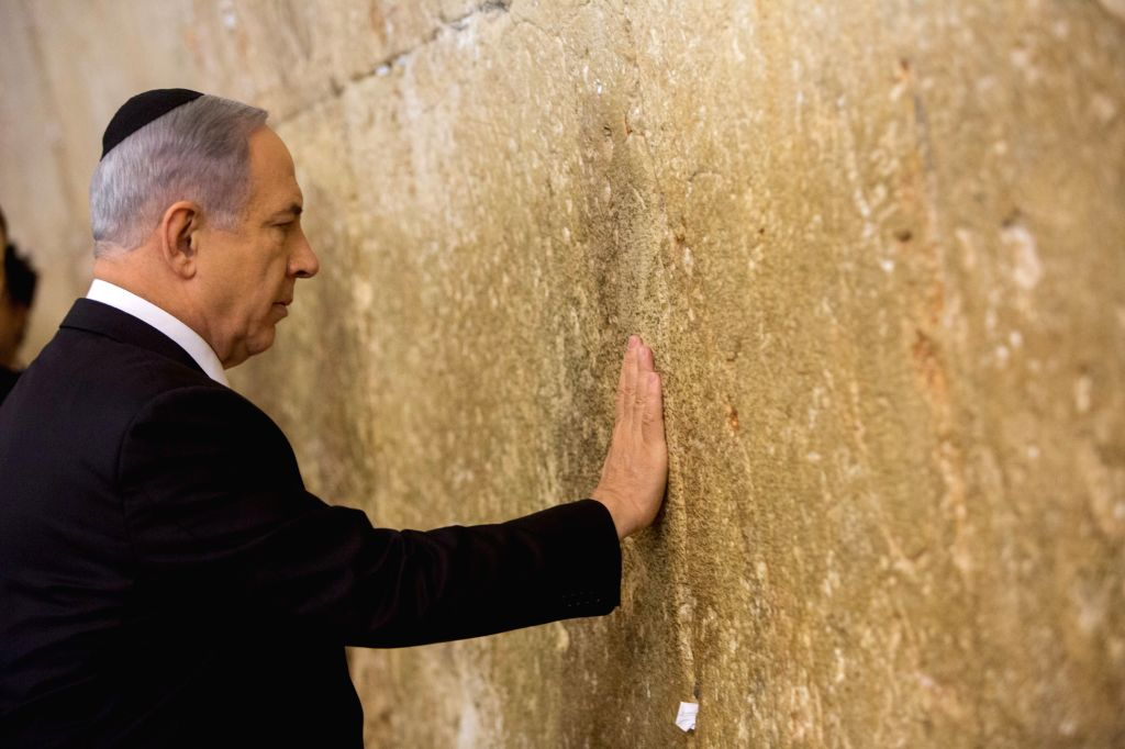 Israeli Prime Minister Benjamin Netanyahu prays at the Jewish site of the Western Wall in the Old City of Jerusalem, on March 18, 2015. Incumbent Israeli Prime ... - Benjamin Netanyahu