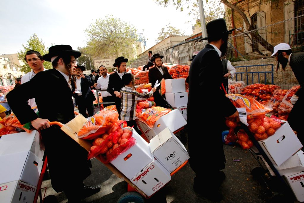 JERUSALEM, March 27, 2018 - Ultra-Orthodox Jews stock up on food for the upcoming Jewish holiday of Passover in Mea Shearim, Jerusalem, on March 27, 2018.