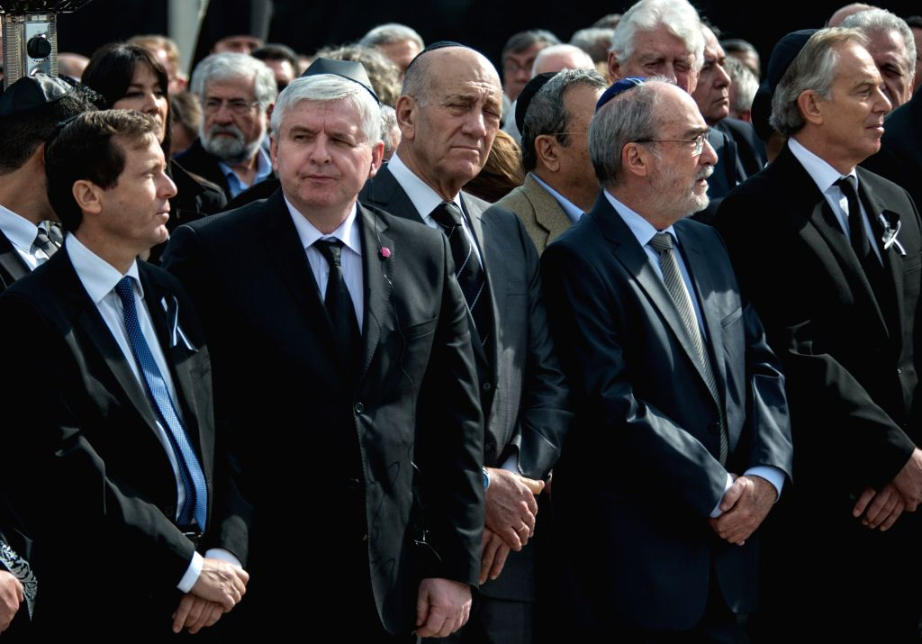 File photo taken on Jan. 13, 2014 shows former Israeli Prime Minister Ehud Olmert (C, Front) during a state memorial ceremony of former Israeli Prime Minister ...