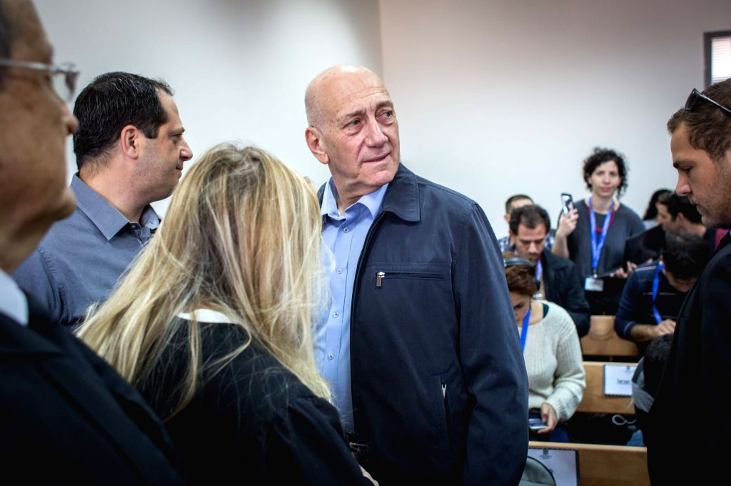 Former Israeli Prime Minister Ehud Olmert (C) waits in a court room before a hearing at Jerusalem's District Court, on March 30, 2015. Former Israeli Prime ... - Ehud Olmert