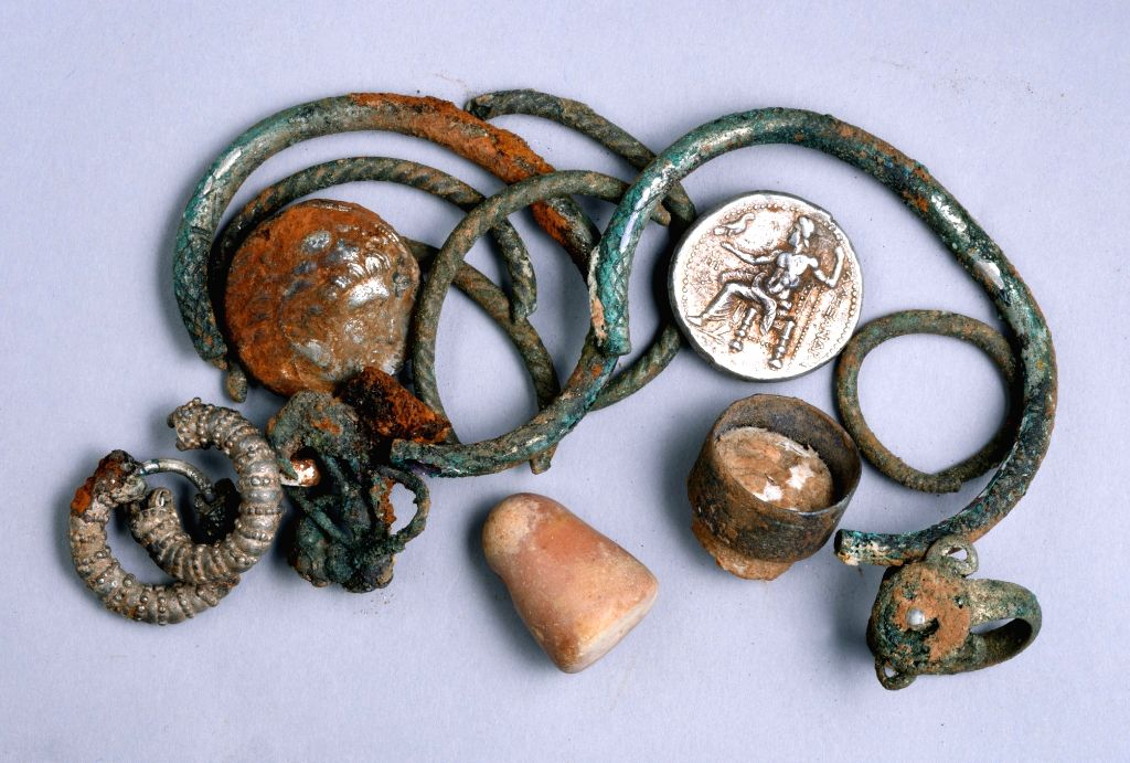 Undated photograph released by Israel Antiquities Authority shows the cache of silver objects found in northern Israel: two coins of Alexander of Macedon, three ...