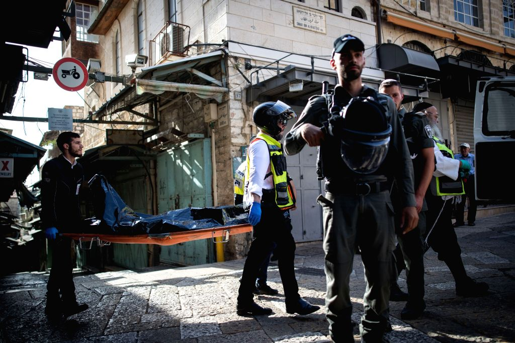 JERUSALEM, May 31, 2019 - Israeli police officers stand guard near the scene of a stabbing attack in Jerusalem's Old City, May 31, 2019. A Palestinian man stabbed two Israelis here on Friday morning ...