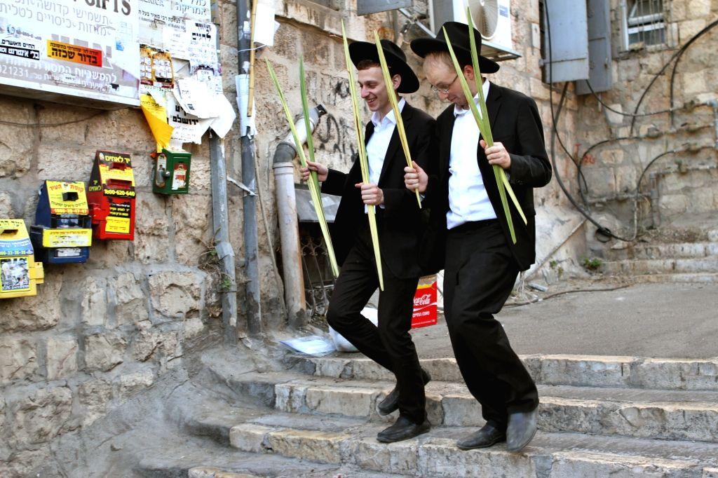 "JERUSALEM, Oct. 3, 2017 - Ultra-Orthodox Jews prepare for the upcoming Jewish holiday of Sukkot in Jerusalem's Mea Shearim neighbourhood, on Oct. 3, 2017. The ""Sukkot"", Feast of ..."
