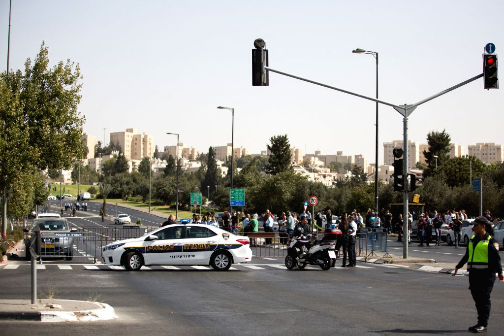 JERUSALEM, Oct. 9, 2016 - Israeli police seal off the scene of the attack in Jerusalem, Oct. 9, 2016. Palestinian health ministry announced Sunday that a Palestinian man was killed after Israeli ...