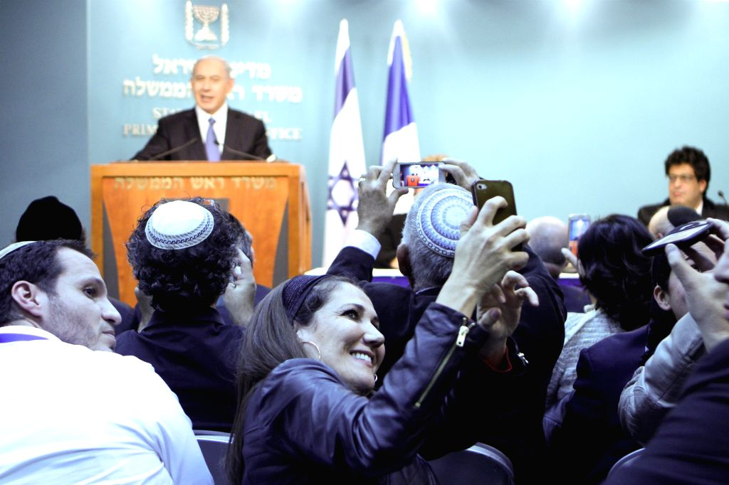 People take photos of a news conference addressed by Israeli Prime Minister Benjamin Netanyahu at the Prime Minister's office in Jerusalem, on Nov. 23, 2014. The Israeli cabinet on Sunday . - Benjamin Netanyahu